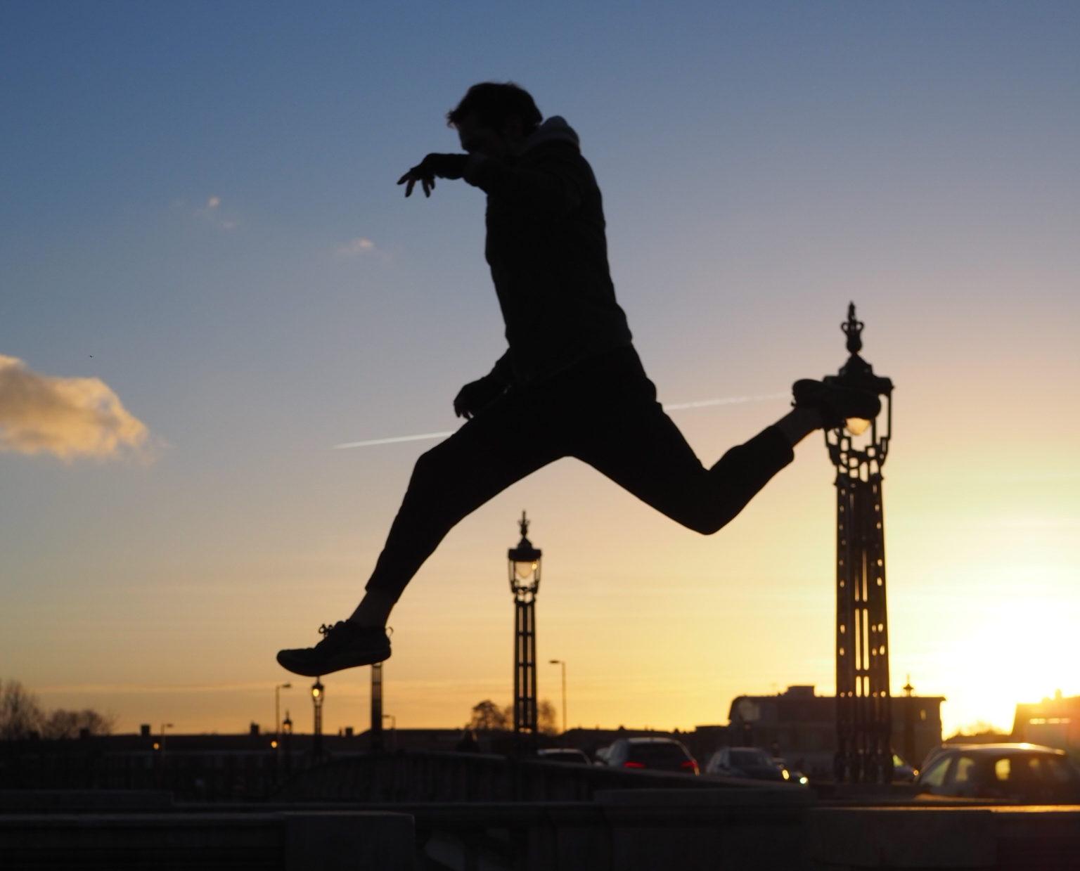 liam leaping hampton court bridge silhouette