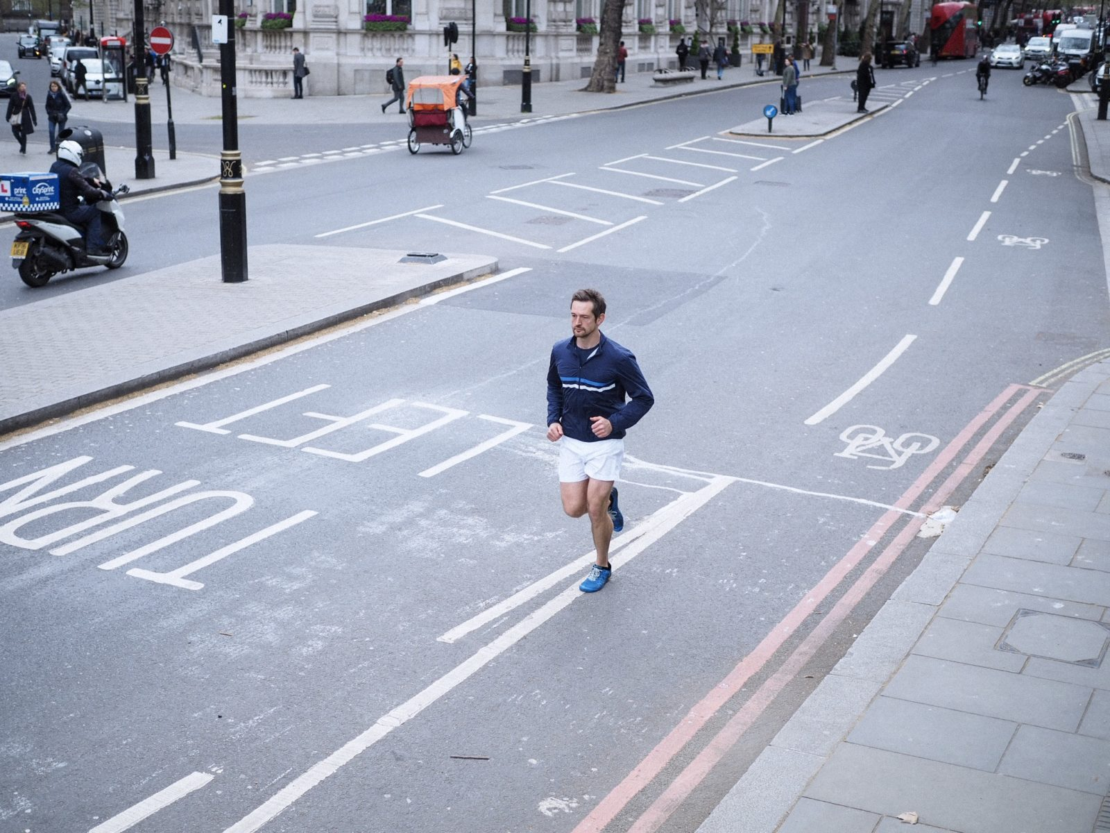 man running streets of london